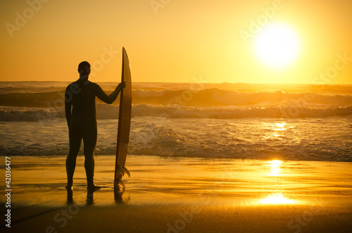 A surfer watching the waves
