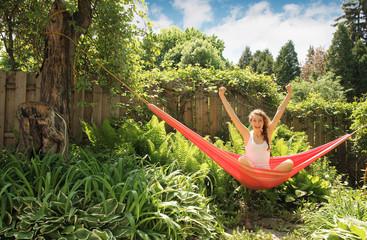 Happy girl in a hammock