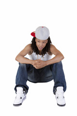 Young Black Woman Sitting Jeans and Baseball Cap