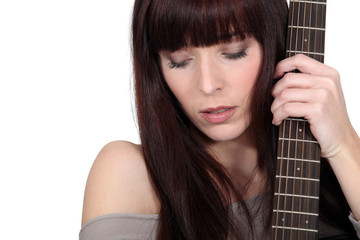 A woman with a guitar.