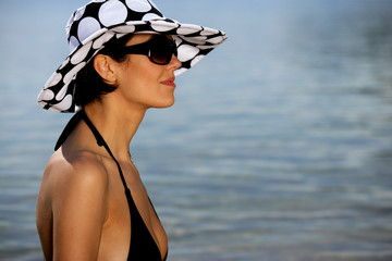 Profile of brunette at the seaside