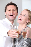 Couple laughing with glasses