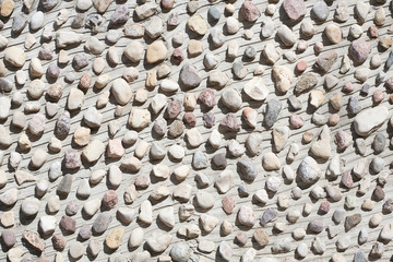 Little stones on a concrete wall