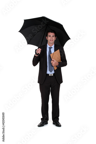 banker with umbrella isolated on white