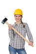 Happy handywoman holding a hammer
