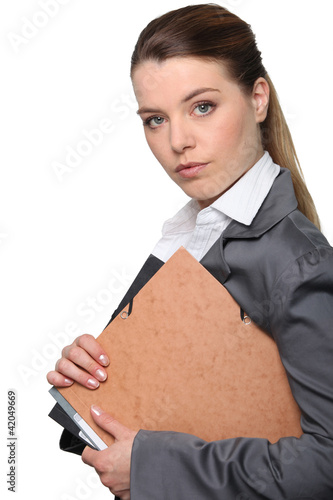 Young businesswoman holding folder