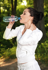 Portrait of young fitness woman with a bottle of water