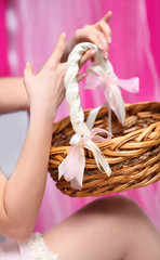 young bride hands hold wicker basket with handle