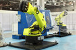 two big new yellow robots for automotive industry at exhibition