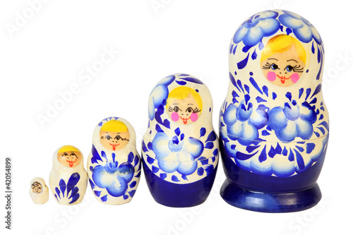 Set of five blue painted Russian matryoshkas isolated on white