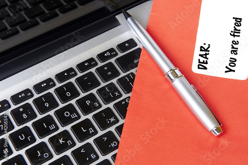 modern laptop and post envelope with pen