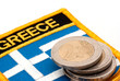 greek flag and euro coins