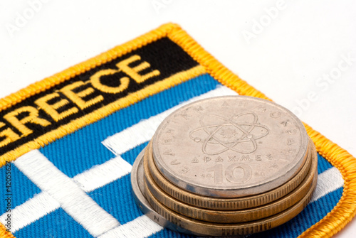 greek flag and drachmas