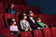 Young family in the movie theater