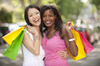 happy multiethnic friends shopping