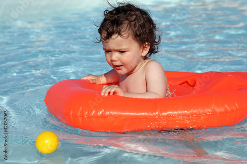 Baby playing in swimming pool