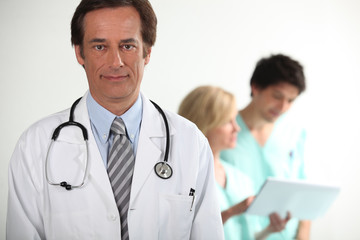 Doctor stood in front of colleagues