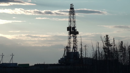 drilling rig at sunset (time lapse)