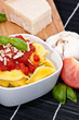Tortellini in a bowl with ingredients