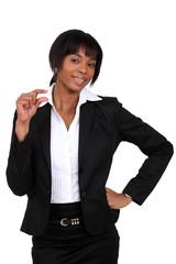 blackk businesswoman showing a little sign