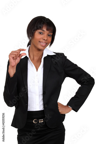blackk businesswoman showing a little sign