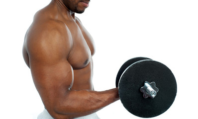 Cropped image of a bodybuilder exercising