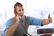 Businessman shouting on phone
