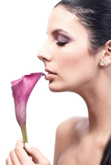Profile of beautiful woman with calla flower