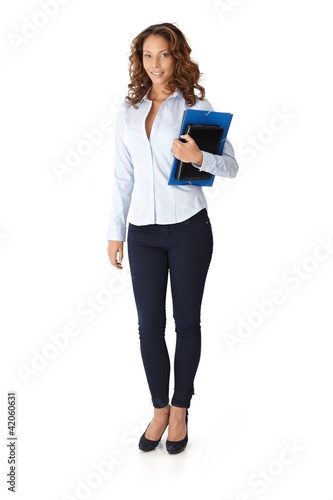 Pretty woman holding folders smiling