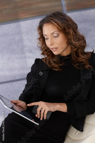 Elegant woman using tablet computer