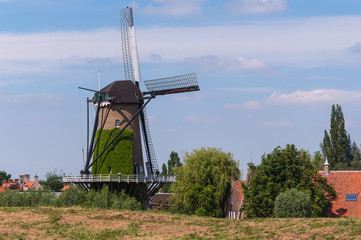Dutch windmill behind a dike