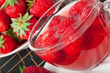 close up of jelly with strawberry in the glass bowl