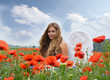 Angel on vacation in a field with red poppies