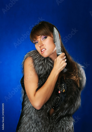 portrait of the brunette with a hunting knife