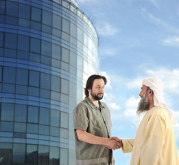 Arabic Muslim businessman meeting outdoors