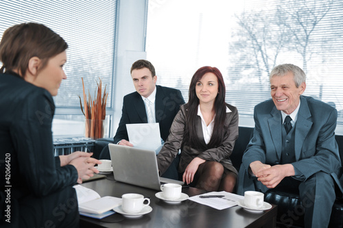 Businesswoman in an interview with three people