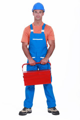 Man holding red tool box