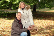 couple of happy pensioners picking chestnuts