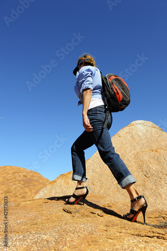 Woman outback hiking in high heels in Australia