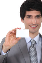 Businessman Holding Up A Blank Business Card Sticker