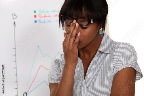 Stressed woman in front of chart
