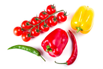 Peppers, chili and tomatoes isolated on white