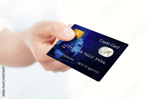 blue credit card holded by hand