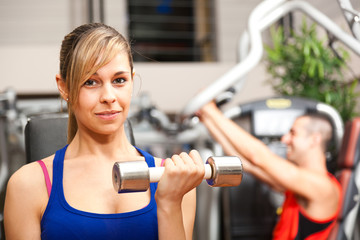 Portrait of a beautiful woman working out in the gym