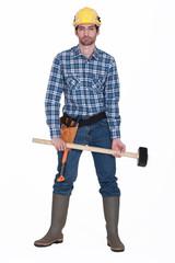 Man holding sledge-hammer