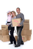 Young family with moving boxes