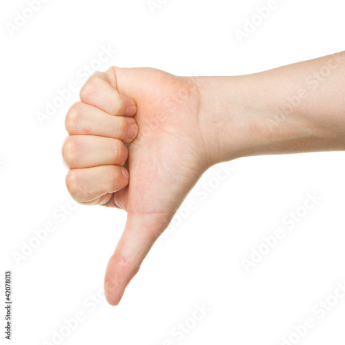 Image of a womans hand showing thumb down