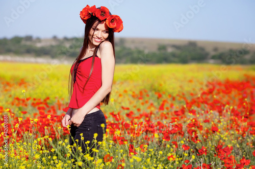 Girl on the poppy meadow