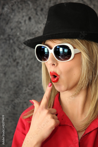 Woman blowing on pretend gun