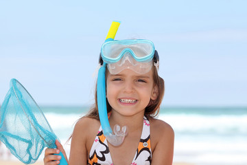 Little girl with snorkel and flippers